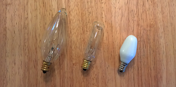 Three different candelabra or E12 light bulbs.