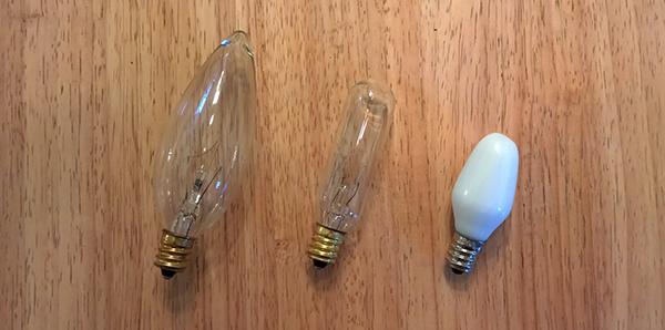 Three different candelabra or E12 light bulbs.